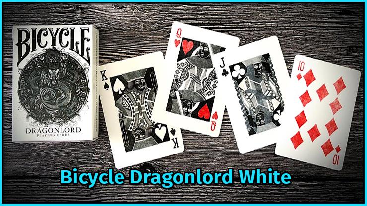 l'étui le roi de pique la dame de cœur le valet de trèfle et le dix de carreau du jeu Bicycle Dragonlord White TCC Compagny