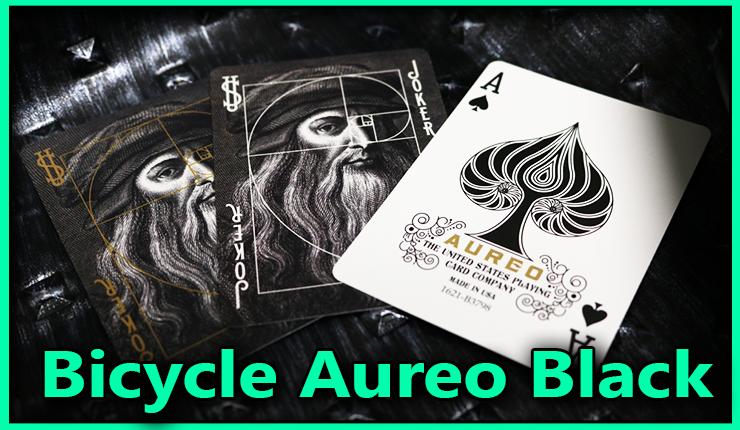 les deux joker de la tete de leonard de vincci avec un gros plan de l'as de pique du jeu bicycle-aureo-black